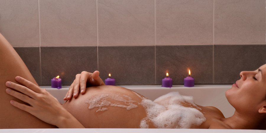 pregnant woman relaxing in bath
