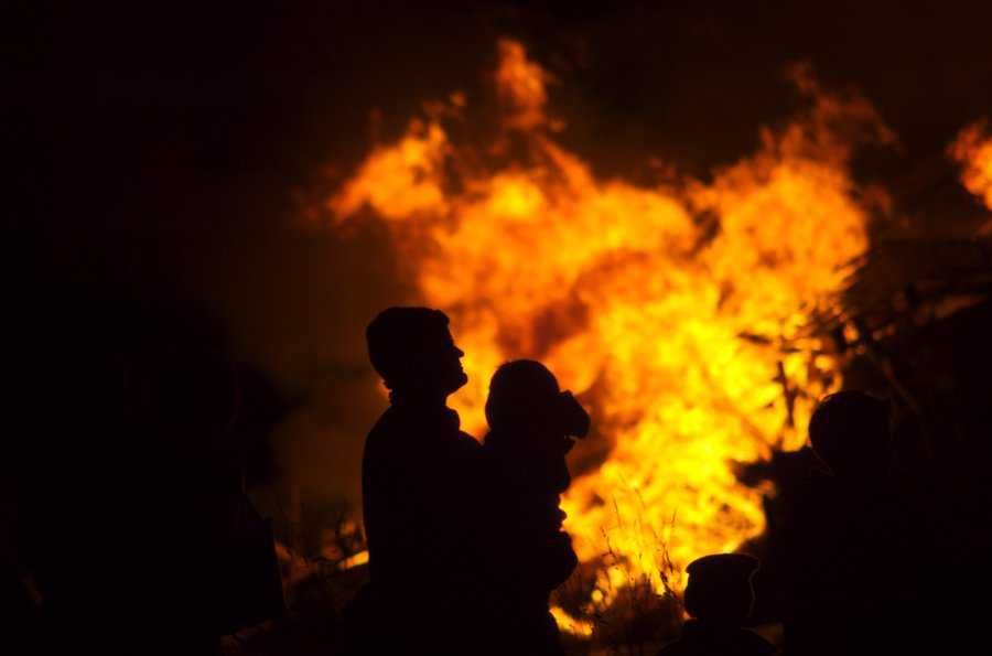 father and baby at bonfire