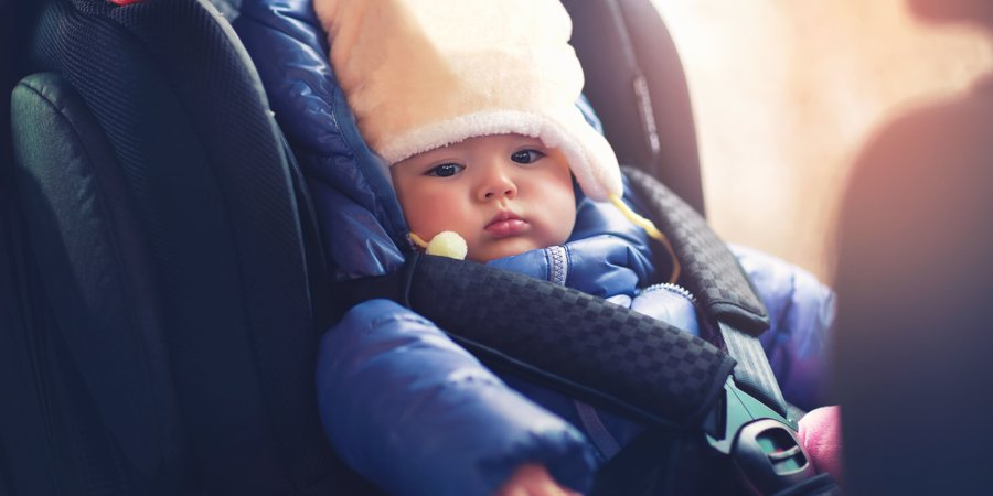 baby wrapped warm in car seat